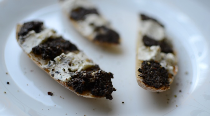 Black olive tapenade and cream cheese crostini