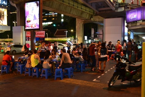 Open-style late night restaurant on a busy Bangkok street
