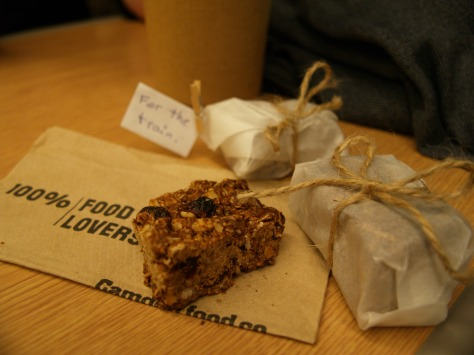Wrap them nicely, grab a coffee before the train - it looks as if you've bought them from a fancy coffee shop!